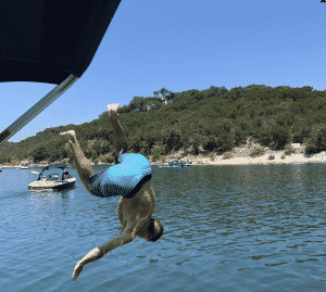 Guy jumping off boat