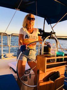 Women driving sailboat