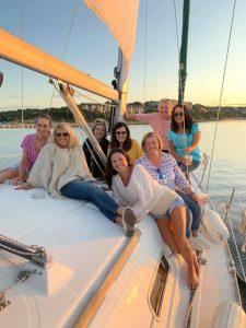 Multiple women on sailboat