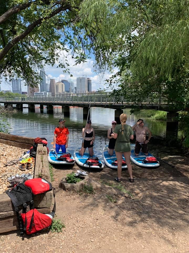 Friends Paddle Boarding In Austin